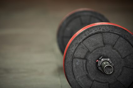 Barbell with black and red weight plates
