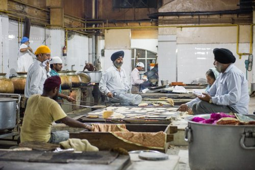 India Travel Writing Expedition -Sikh Temple men flipping flat bread