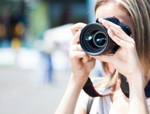 Female photographer using a digital camera