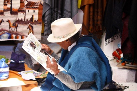 Photo of a man reading the paper licensed by ImageBrief