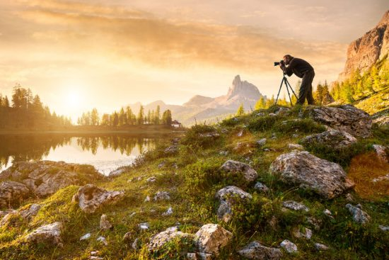 Man using a tripod to get sharp photos