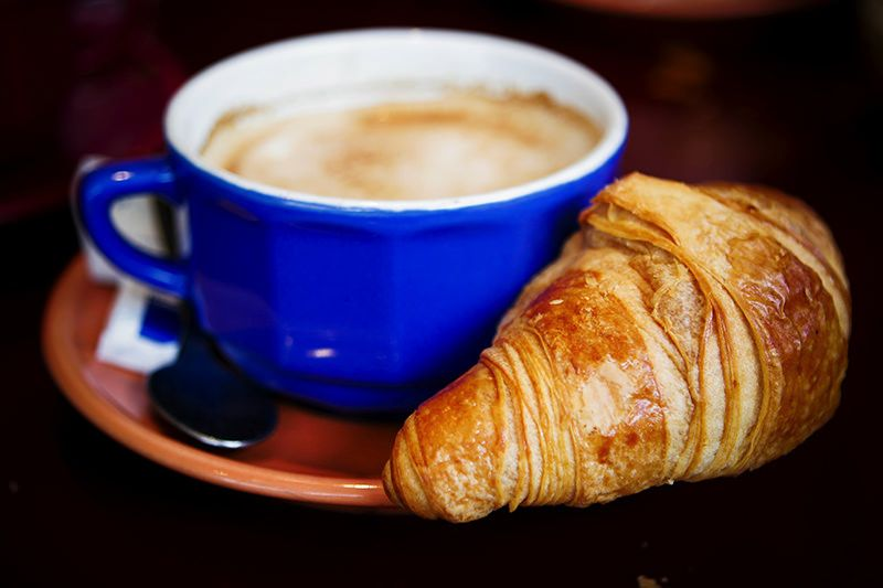 a-cup-of-coffee-and-a-croissant