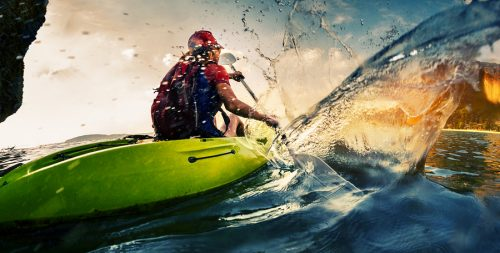 Stock photography capturing a kayaker in action