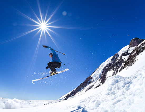 Skier jumping with sun beam stock photo camera settings